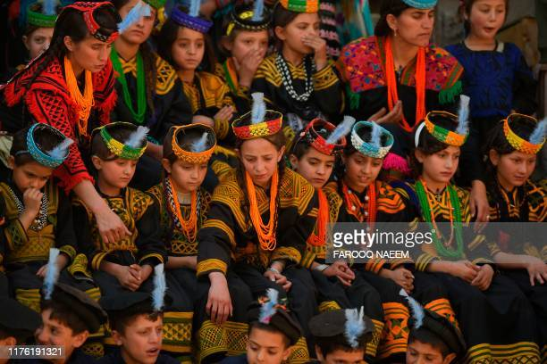 Kalash tribe children wait for the arrival of Britain's Prince William Duke of Cambridge and Catherine Duchess of Cambridge in the Bumburate Valley...