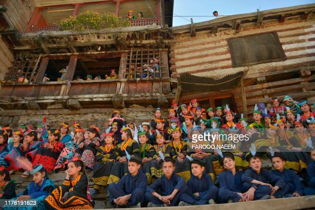 Kalash tribe children wait for the arrival of Britain's Prince William Duke of Cambridge and Catherine Duchess of Cambridge at the Bumburate Valley...