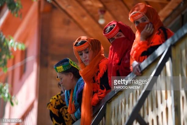 Kalash tribe girls wait for the arrival of Britain's Prince William Duke of Cambridge and Catherine Duchess of Cambridge in the Bumburate Valley in...