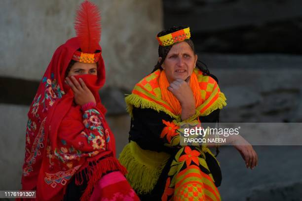 Kalash tribe women wait for the arrival of Britain's Prince William Duke of Cambridge and Catherine Duchess of Cambridge in the Bumburate Valley in...