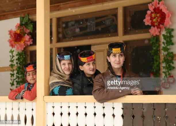 Kalash women pose for a photo in their traditional dresses in Chitral in northern Khyber Pakhtunkhwa, Pakistan on January 02, 2020. Kalash people who...
