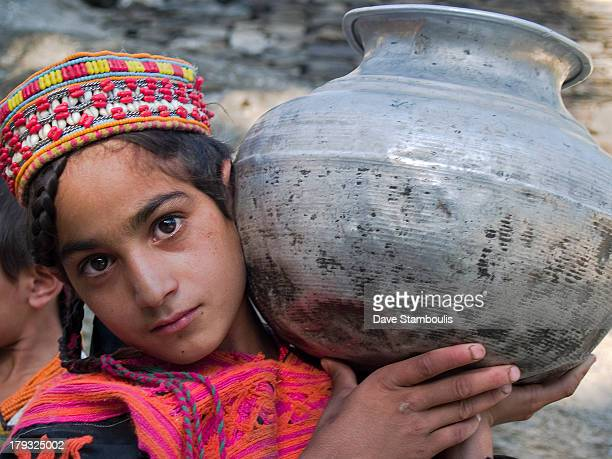 Kalasha girl and her water jug, Chitral Valley, Pakistan