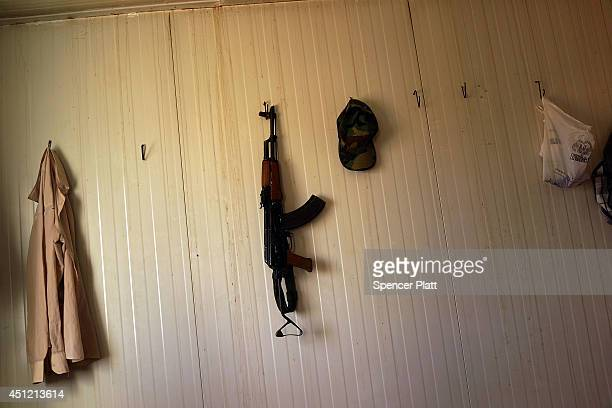 Kalashnikov rifle hangs on a wall inside a Peshmerga base near the frontline with Sunni militants on the outskirts of Kirkuk an oilrich Iraqi city on...