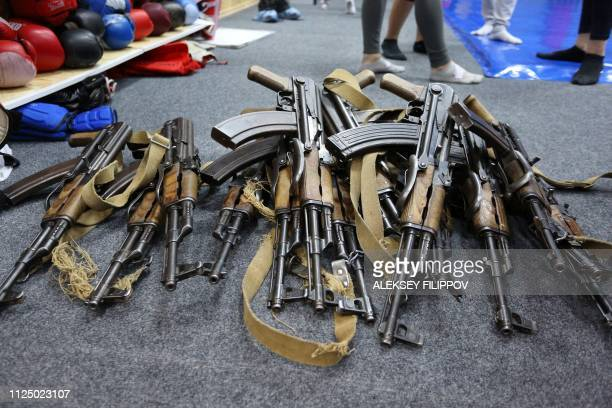 Kalashnikov weapons are on display during a women and girls' two-hour session to learn gun handling basics and hand-to-hand combat at a shopping mall...