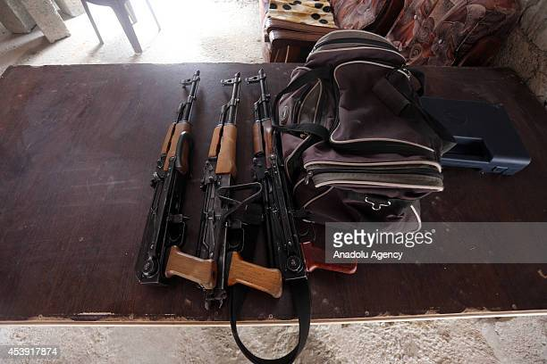 Kalashnikovs are seen at a Arbil Gun Bazaar in Kasnazan near the Arbil Iraq on August 20 2014 Dealers say that sales of weapons at the market have...