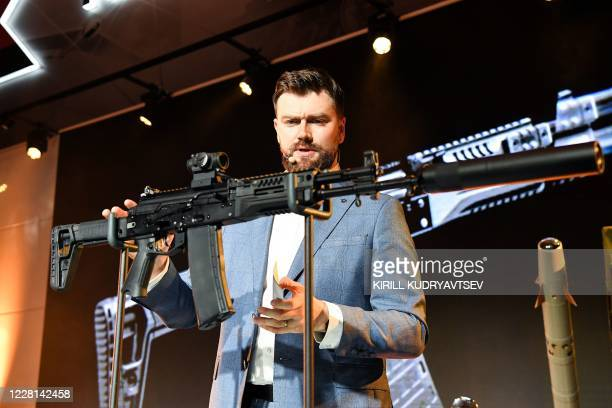 Kalashnikov's director Dmitry Tarasov presents the new AK-19 automatic rifle in the Kalashnikov expo centre prior to the International...