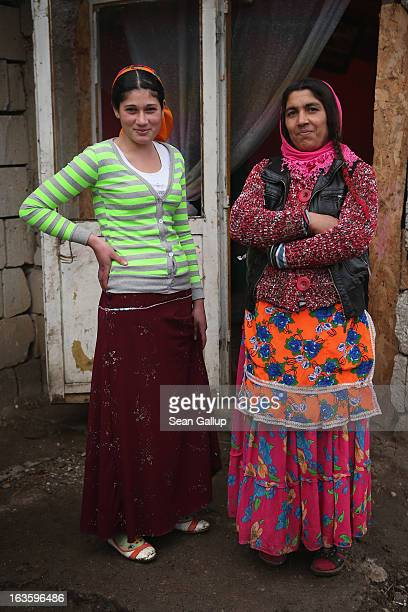 Kalderash Roma Maria Mihai and one of her daughters allow a visitor to photograph them in the doorway of their home in the Kalderash corner of town...