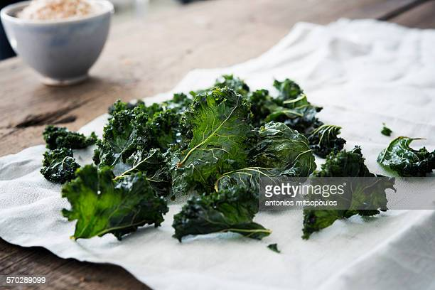 kale chips - kale stock pictures, royalty-free photos & images