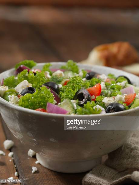 kale greek salad - kalamata olive stock pictures, royalty-free photos & images