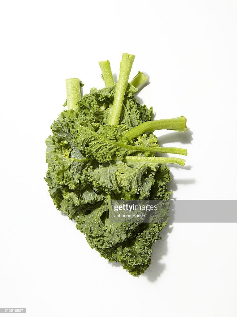 Kale in shape of a human heart : Stock Photo