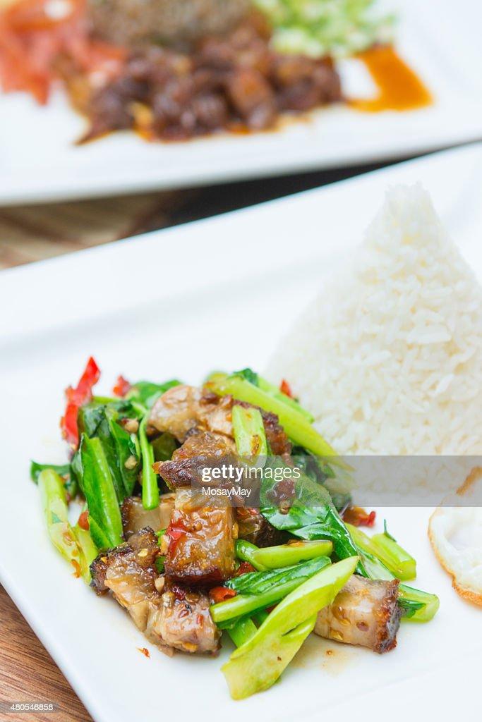 Kale with crispy pork and rice : Stock Photo