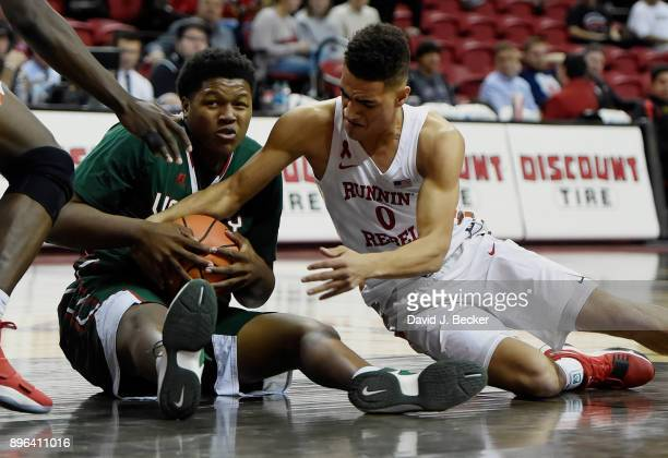 Kaleb Allison of the Mississippi Valley State Delta Devils and Jay Green of the UNLV Rebels vie for a loose ball during the second half at the Thomas...