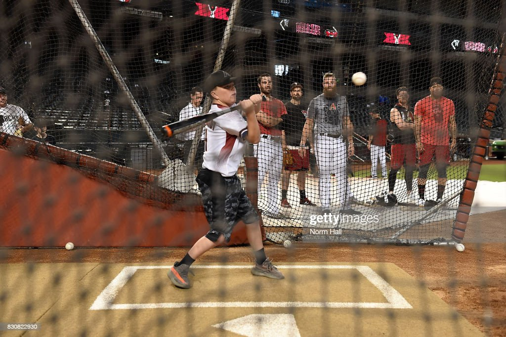 Kaleb Boop from the Make-A-Wish Foundation takes batting practice with Arizona Diamondbacks players prior to a game against the Chicago Cubs at Chase Field on August 12, 2017 in Phoenix, Arizona.