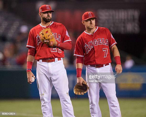 Kaleb Cowart and Cliff Pennington of the Los Angeles Angels of Anaheim wait as a play that would have been the final out of the top of the fifth...
