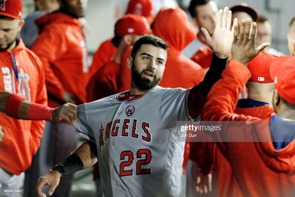 Kaleb Cowart #22 of the Los Angeles Angels of Anaheim is congratulated in the dugout after after scoring on an RBI single by Eric Young Jr. #8 (not pictured) during the fifth inning at Guaranteed Rate Field on September 28, 2017 in Chicago, Illinois.