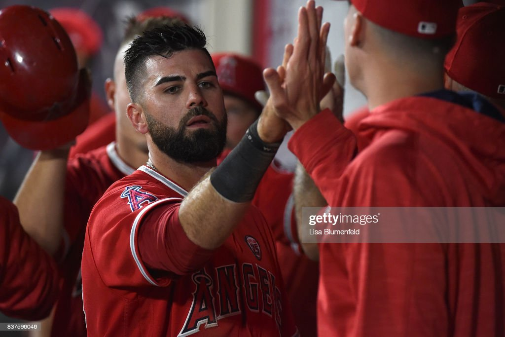 Kaleb Cowart #22 of the Los Angeles Angels of Anaheim returns to the dugout after scoring in the fourth inning against the Texas Rangers at Angel Stadium of Anaheim on August 22, 2017 in Anaheim, California.