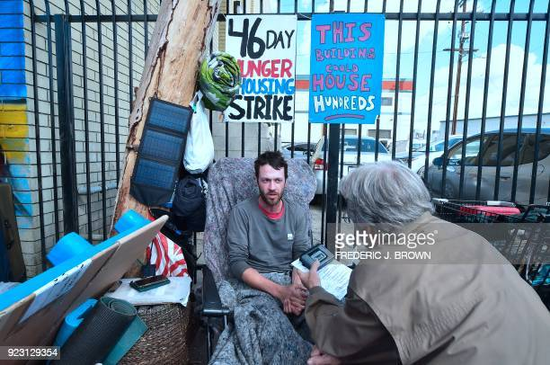 Kaleb Havens a Catholic worker speaks to a reporter as he continues his Lent hunger strike on February 22 in the skid row section of Los Angeles...