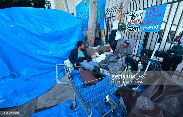 TOPSHOT Kaleb Havens a Catholic worker speaks with a homeless neighbor as he continues his Lent hunger strike on February 22 in the skid row section...