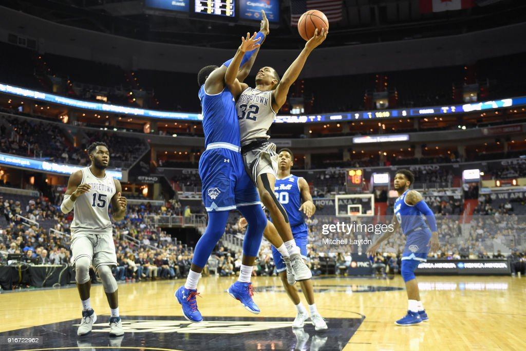 Kaleb Johnson #32 of the Georgetown Hoyas drives to the basket by Angel Delgado #31 of the Seton Hall Pirates during a college basketball game at Capital One on February 10, 2018 in Washington, DC.