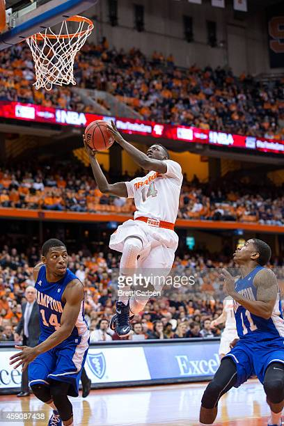 Kaleb Joseph of the Syracuse Orange flies past Deron Powers and Brian Darden of the Hampton Pirates to put in a layup in the second half on November...
