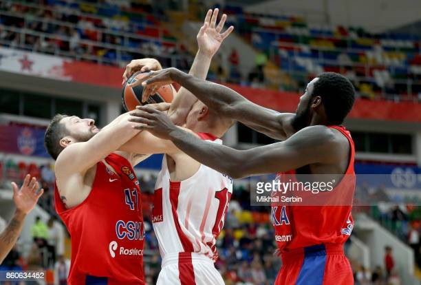 Kaleb Tarczewski #15 of AX Armani Exchange Olimpia Milan competes with Nikita Kurbanov #41 and Othello Hunter #44 of CSKA Moscow in action during the...