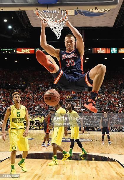 Kaleb Tarczewski of the Arizona Wildcats dunks against the Oregon Ducks during a semifinal game of the Pac12 Basketball Tournament at MGM Grand...