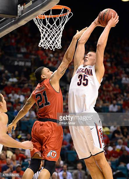 Kaleb Tarczewski of the Arizona Wildcats goes in for a dunk against Jordan Loveridge of the Utah Utes during a quarterfinal game of the Pac-12...