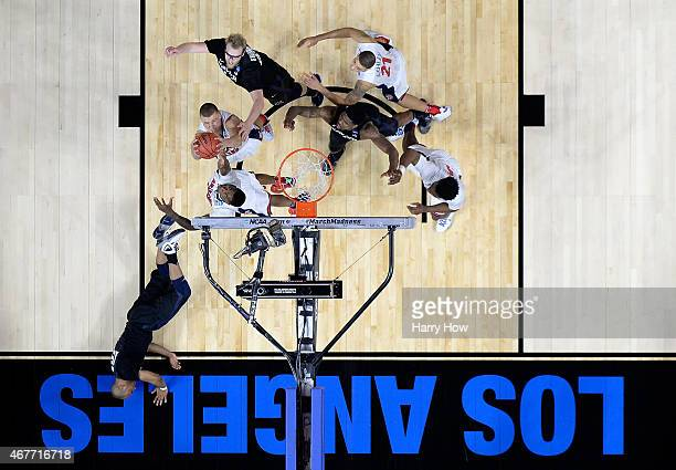 Kaleb Tarczewski of the Arizona Wildcats rebounds the ball in front of Matt Stainbrook of the Xavier Musketeers in the first half during the West...