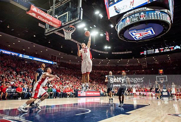Kaleb Tarczewski of the Arizona Wildcats slam dunks against the Mount St Marys Mountaineers at McKale Center on November 14 2014 in Tucson Arizona