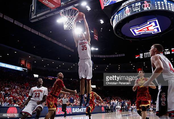 Kaleb Tarczewski of the Arizona Wildcats slam dunks the ball against the USC Trojans during the first half of the college basketball game at McKale...
