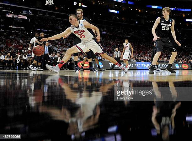 Kaleb Tarczewski of the Arizona Wildcats with the ball against Matt Stainbrook of the Xavier Musketeers in the first half during the West Regional...