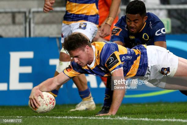 Kaleb Trask of Bay of Plenty dives over to score a try during the round eight Mitre 10 Cup match between Otago and Bay of Plenty at Forsyth Barr...