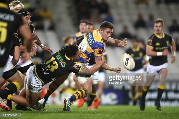 Kaleb Trask of Bay of Plenty offloads in a tackle during the Round 5 Mitre 10 Cup match between Bay of Plenty and Wellington at Rotorua International...
