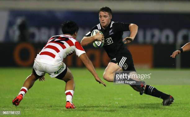 Kaleb Trask of New Zealand takes on Yuto Mori during the World Rugby U20 Championship match between New Zealand and Japan at Stade d'Honneur du Parc...