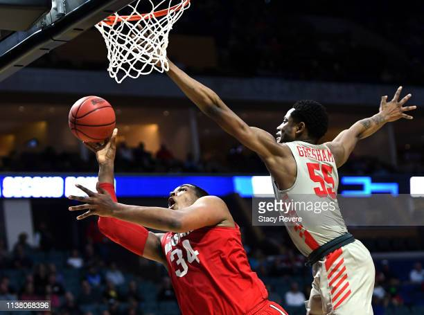 Kaleb Wesson of the Ohio State Buckeyes is fouled by Brison Gresham of the Houston Cougars during the second half of the second round game of the...