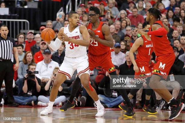 Kaleb Wesson of the Ohio State Buckeyes looks to pass the ball while being guarded by Jalen Smith of the Maryland Terrapins at Value City Arena on...