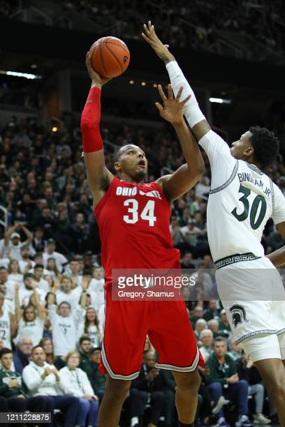 Kaleb Wesson of the Ohio State Buckeyes takes a shot over Marcus Bingham Jr #30 of the Michigan State Spartans during the second half at the Breslin...