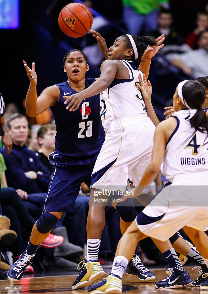 Kaleena Mosqueda-Lewis #23 of the Connecticut Huskies and Jewell Loyd #32 of the Notre Dame Fighting Irish battle for the ball at Purcel Pavilion on March 4, 2013 in South Bend, Indiana. Notre Dame defeated Connecticut 96-87 in triple overtime to win the Big East regular season title.
