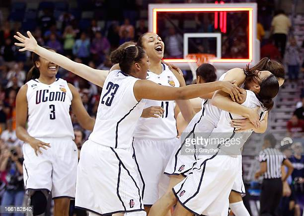 Kaleena MosquedaLewis of the Connecticut Huskies celebrates with teammates after defeating the Louisville Cardinals during the 2013 NCAA Women's...