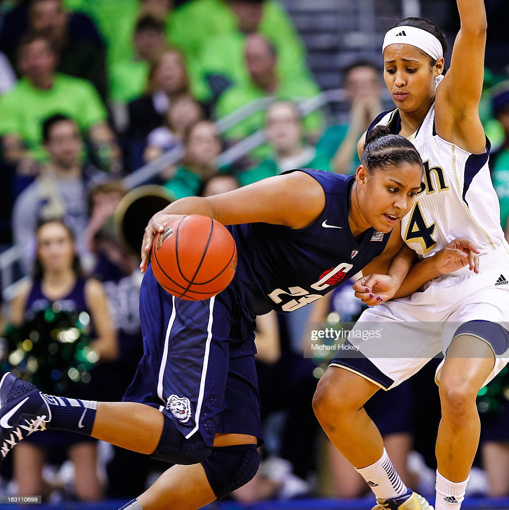 Kaleena Mosqueda-Lewis #23 of the Connecticut Huskies dribbles against Skylar Diggins #4 of the Notre Dame Fighting Irish at Purcel Pavilion on March 4, 2013 in South Bend, Indiana. Notre Dame defeated Connecticut 96-87 in triple overtime to win the Big East regular season title.