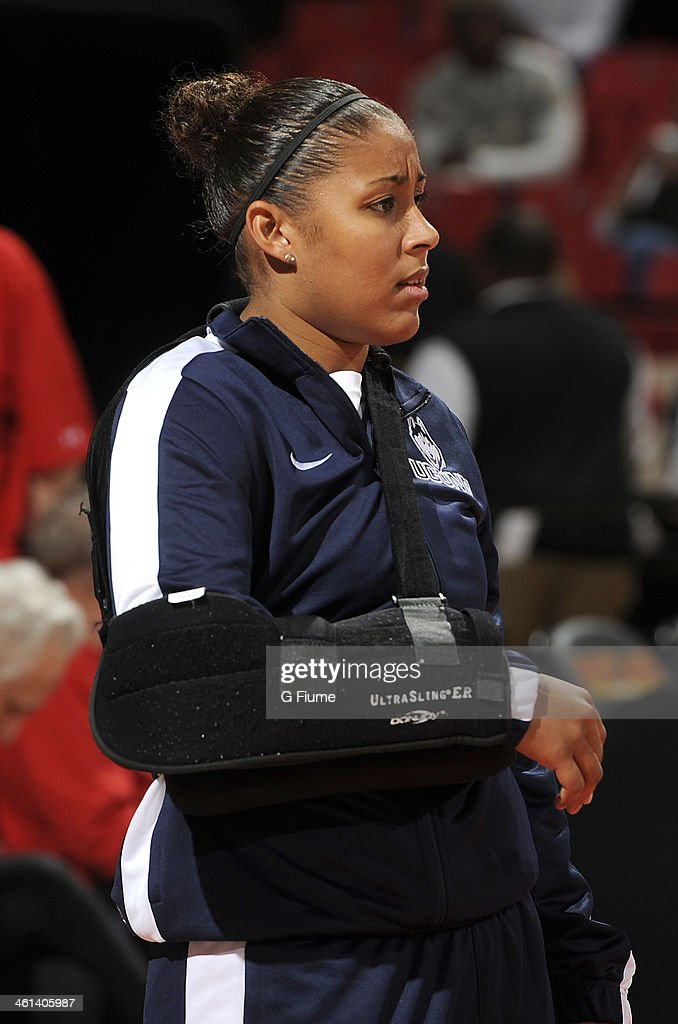 Kaleena Mosqueda-Lewis #23 of the Connecticut Huskies watches the team warm up before the game against the Maryland Terrapins at the Comcast Center on November 15, 2013 in College Park, Maryland.