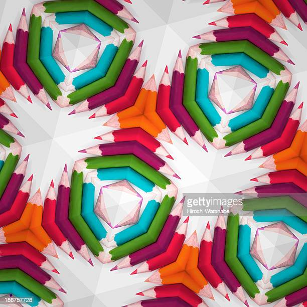 kaleidoscope of colored pencils - kaleidoscope stock photos and pictures