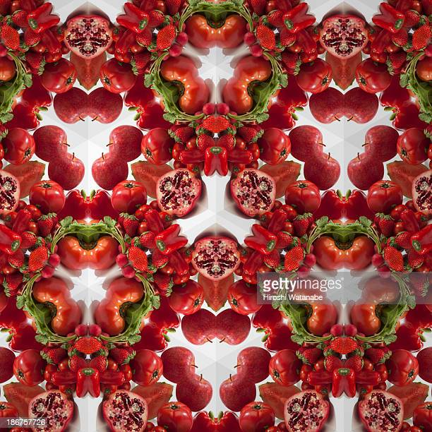 kaleidoscope of red vegetables and fruits - kaleidoscope stock photos and pictures