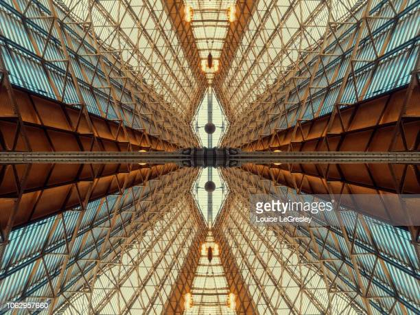 kaleidoscopic image of a parisiens train station - radial symmetry stock pictures, royalty-free photos & images