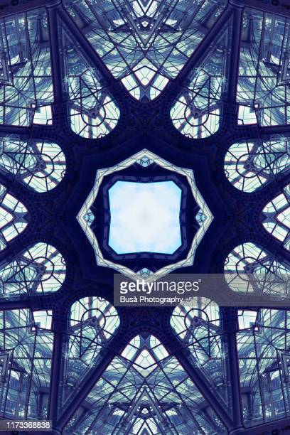 kaleidoscopic image of glass roof of crystal palace (palacio de cristal) in el retiro park in madrid, spain - intricacy stock pictures, royalty-free photos & images