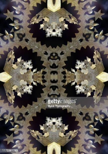 kaleidoscopic image of star-shaped golden decoration - expense stock pictures, royalty-free photos & images