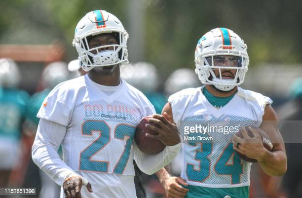 """Kalen Ballage and Kenneth Farrow of the Miami Dolphins performing practice drills during the third week OTA""""u2019s at Baptist Health Training..."""