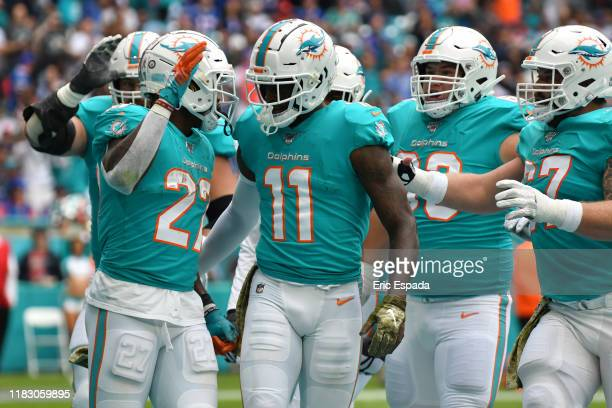 Kalen Ballage of the Miami Dolphins celebrates with teammates after scoring a touchdown in the second quarter against the Buffalo Bills at Hard Rock...