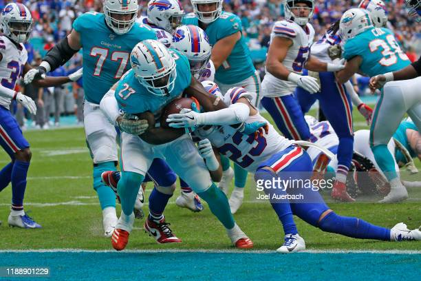 Kalen Ballage of the Miami Dolphins scores against the Buffalo Bills during an NFL game on November 17, 2019 at Hard Rock Stadium in Miami Gardens,...