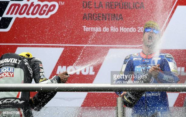 Kalex biker's Mattia Pasini of Italy and Xavi Vierge of Spain celebrete at the podium their first and second place respectively in the Moto2 race of...